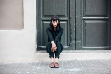 Woman waiting in front of a door