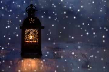 Christmas lantern with snowflakes and stars on a blue background.