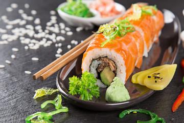 Japanese sushi set on a rustic dark background.