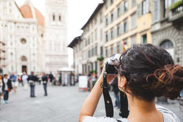 Young Woman Photographing Old Italian Architecture with an Analog Camera