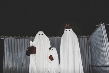 Family ghosts ready to go out at night