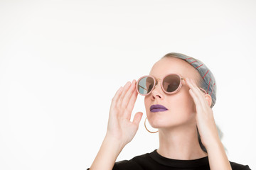 White female looking up with sunglasses