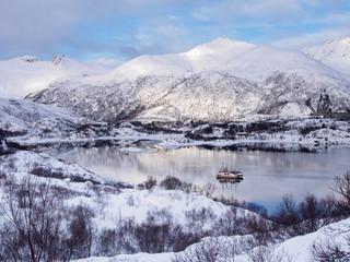 Two fishing boats on the sea near Svolvaer on Lofoten islands, Norway in winter