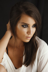 Studio portrait of a beautiful brunette woman