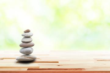 Foto op Plexiglas Stenen in het Zand zen stones on wooden in the garden. Concept relaxation, zen, spring, spa.