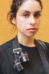 Portrait of a Young Pretty Photographer with Film Holders on the Camera Strap