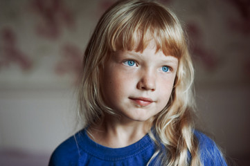 Portrait of a girl in a blue t-shir