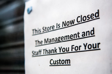 "Sign advising customers that ""This store is now closed. The management and Staff thank you for your custom"""
