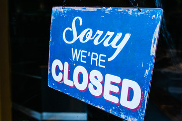 "Sign on a shop saying ""Sorry. We're closed"""