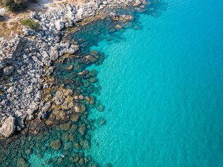 Aerial View: Drone video of iconic beach of Agathi and castle of Feraklos, Rodos island, Aegean, Greece