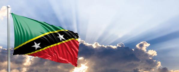Saint Kitts and Nevis flag on blue sky. 3d illustration