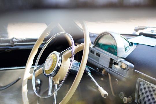 classic american car car steering wheel and dashboard