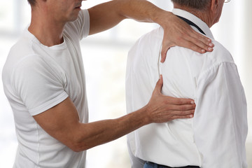 Man having chiropractic back adjustment. Osteopathy, Physiotherapy concept.