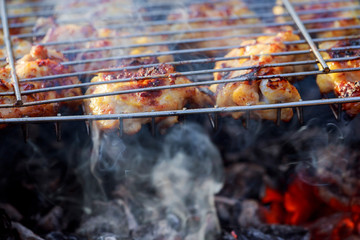Close up grilled whole chicken on stove