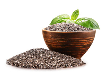 Bowl of chia seeds isolated on white