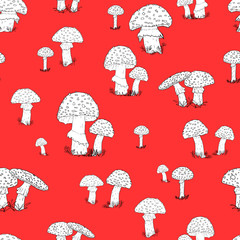 Seamless pattern with hand drawn mushrooms on the red background