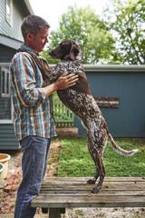 a man hugging his dog