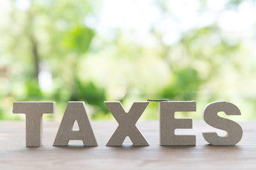tax concept.  High Angle View Of  tax return Word On Wooden Background