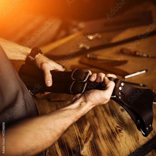 Working process of the leather craft in the workshop  Man