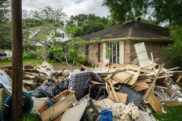 Trash and debris outside of neighborhoods devastated by Hurricane Harvey