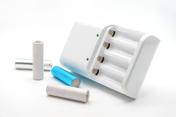 AA batteries rechargeable in accumulator charger, isolated on a white background