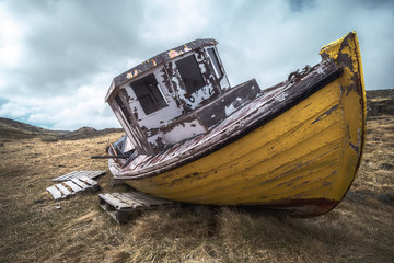 Old Fishing Boat with Dramatic Sky in the Westfjords, Iceland