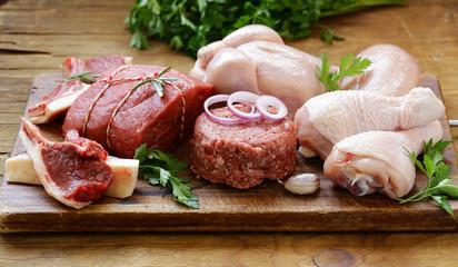 Deurstickers Vlees raw meat assortment - beef, lamb, chicken on a wooden board