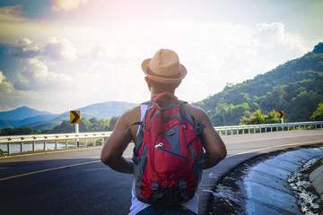 Portrait of American man backpack looking mountain view of Asia