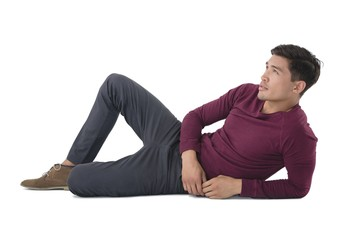 Full length of businessman reclining while looking away