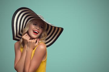 Pop art portrait of beautiful woman in hat. Blue background.