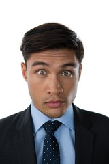 Portrait of young businessman with raised eyebrows