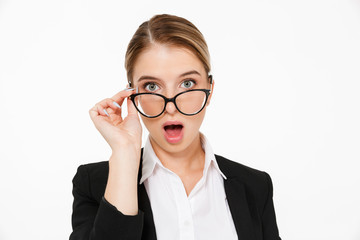 Close up picture of Surprised blonde business woman in eyeglasses