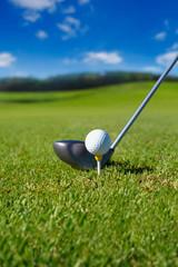 Golf club with ball on tee