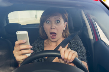 beautiful woman  driving car while texting using mobile phone distracted