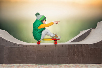 Little boy skateboarding on steep jumps.Extreme sports.
