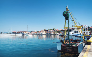 Fishing boat stands moored in port
