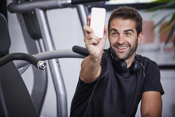 Sports guy smiling for Smartphone selfie