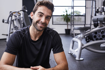 Portrait of confident gym guy, smiling