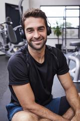 Smiling athlete wearing headphones, portrait
