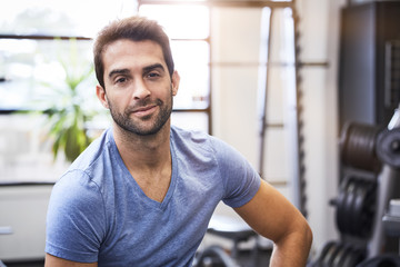 Gym dude in t-shirt looking at camera