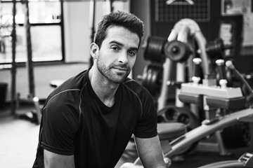 Handsome guy in gym looking at camera