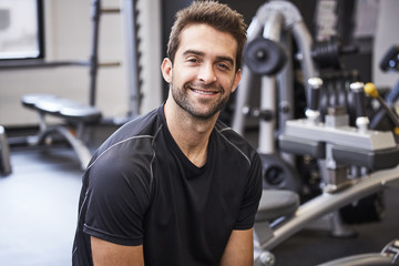 Smiling dude happy to be in gym, portrait