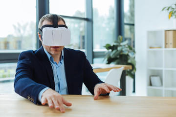 Serious successful businessman wearing 3d glasses