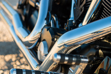 Exhaust and motorcycle engine closeup