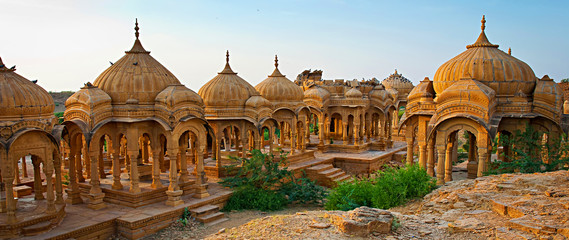 Deurstickers India The royal cenotaphs of historic rulers, also known as Jaisalmer Chhatris, at Bada Bagh in Jaisalmer made of yellow sandstone at sunset