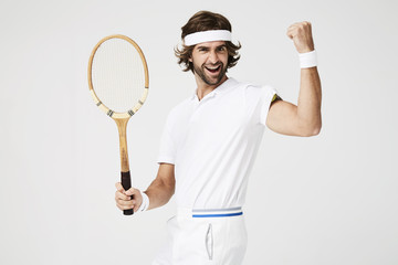 Cheering tennis dude with racket, portrait