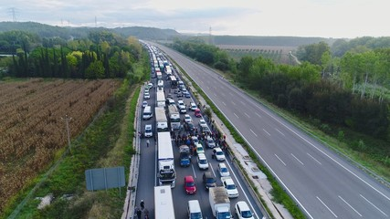 Highway completely blocked by protesters cause of Strike for Catalan Independence from Spain - News Editorial Aerial Picture taken on October 3rd 2017