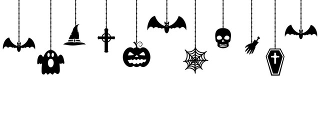 Halloween ornaments hanging on white background