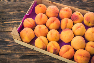 peaches in a wooden box