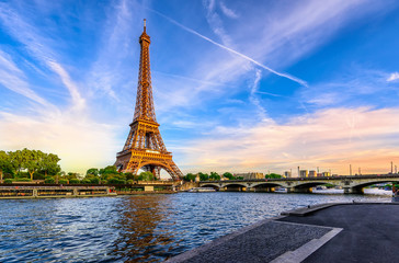 Wall Mural - Paris Eiffel Tower and river Seine at sunset in Paris, France. Eiffel Tower is one of the most iconic landmarks of Paris.